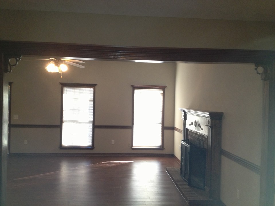 huge den w fireplace , new custom flooring all new flooring